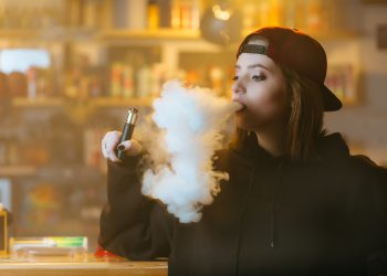 Confused vaping woman  - Stock Image